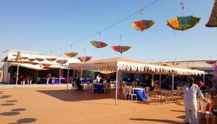 Shopping Handmade Umbrella in Rann Utsav Kutch Gujarat